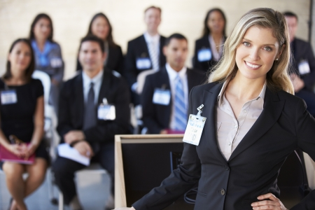 conference audience: Businesswoman Delivering Presentation At Conference