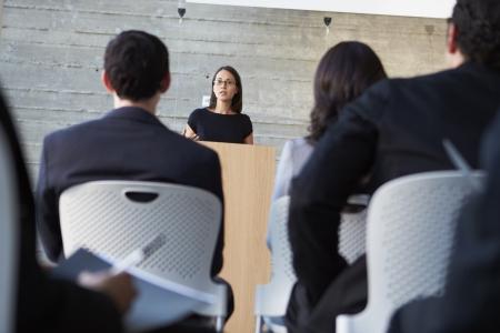 delegates: Businessman Delivering Presentation At Conference Stock Photo