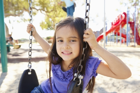 Girl On Swing In Park photo