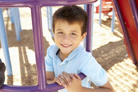 climbing frame: Boy On Climbing Frame In Park