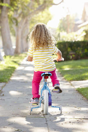 Girl Learning To Ride Bike On Path photo