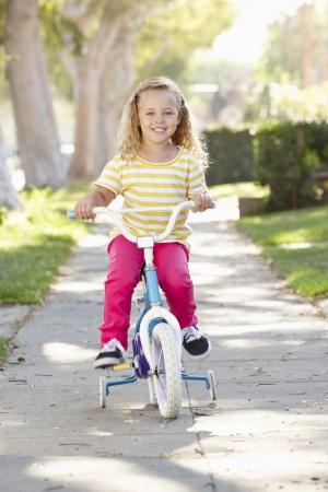 Girl Wearing Rucksack Cycling To School Stock Photo
