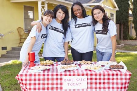 fundraising: Team Of Women Running Charity Bake Sale