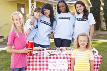 fundraising: Women And Children Running Charity Bake Sale