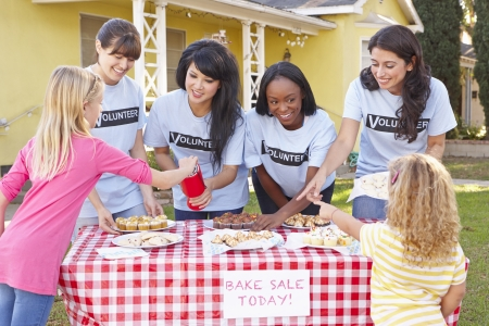 helping people: Women And Children Running Charity Bake Sale
