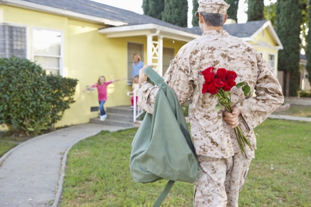military uniform: Family Welcoming Husband Home On Army Leave
