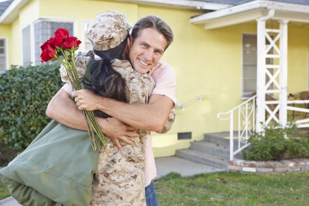 army man: Husband Welcoming Wife Home On Army Leave Stock Photo