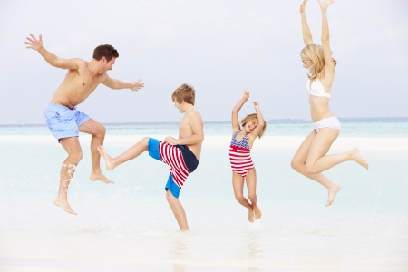 Family Having Fun In Sea On Beach Holiday Stock Photo - 19530085