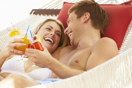 Romantic Couple Relaxing In Beach Hammock Stock Photo - 19530058