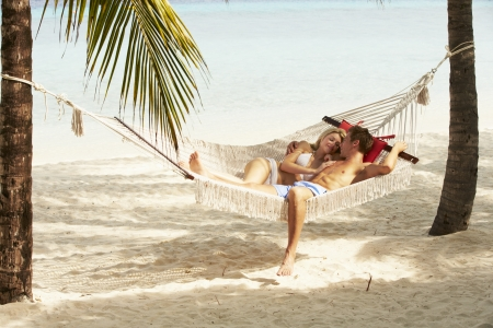Romantic Couple Relaxing In Beach Hammock Reklamní fotografie