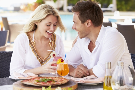 Dining: Couple Enjoying Meal In Outdoor Restaurant Stock Photo