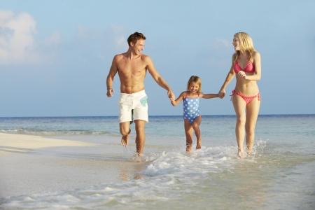 Family Having Fun In Sea On Beach Holiday Stock Photo - 19530365