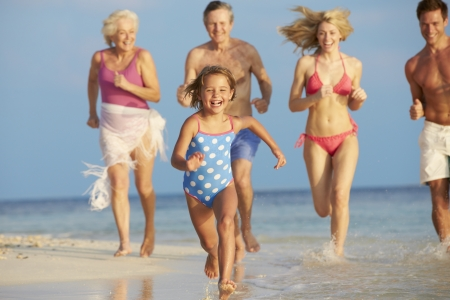 grandparents: Multi Generation Family Having Fun In Sea On Beach Holiday