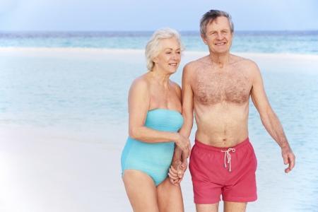 Senior Romantic Couple Walking In Beautiful Tropical Sea Stock Photo - 19530476