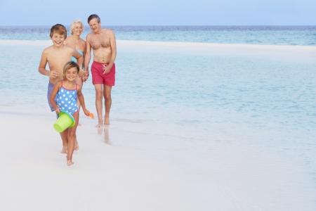 Woman In Bikini Splashing In Beautiful Tropical Sea