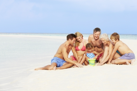 Multi Generation Family Having Fun On Beach Holiday photo