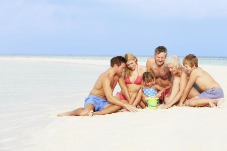Multi Generation Family Having Fun On Beach Holiday Stock Photo - 19530306