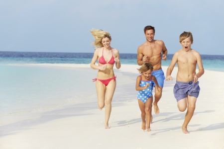 Family Having Fun On Beach Holiday photo
