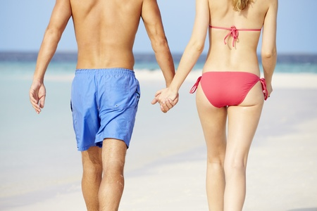 Close Up Of Romantic Couple Walking On Tropical Beach Stock Photo - 19530254