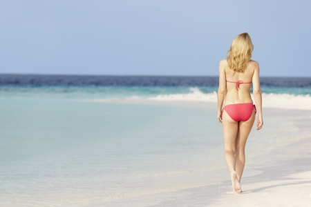 swimsuit: Woman In Bikini Walking On Beautiful Tropical Beach