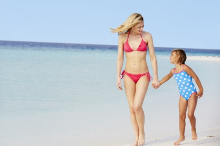 two year old: Mother And Daughter Walking On Beautiful Beach Stock Photo