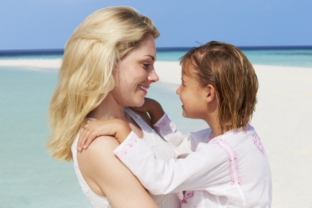 5 year old girl: Mother And Daughter Hugging On Beautiful Beach