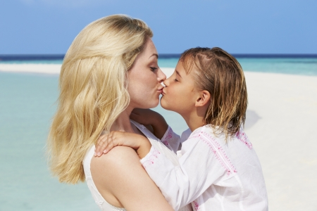 beach kiss: Mother And Daughter Hugging On Beautiful Beach