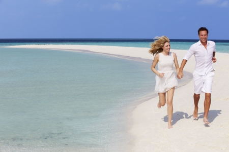 honeymoon couple: Romantic Couple Running On Beautiful Tropical Beach
