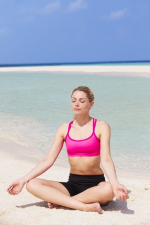 Woman Meditating On Beautiful Beach photo