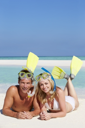 Couple With Snorkels Enjoying Beach Holiday photo