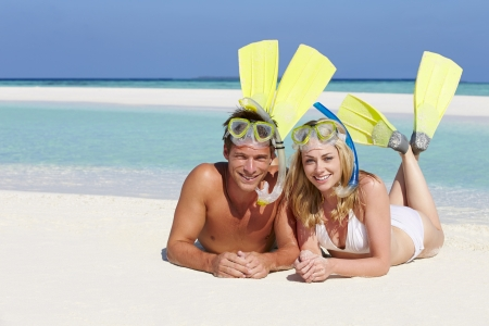 snorkelling: Couple With Snorkels Enjoying Beach Holiday Stock Photo
