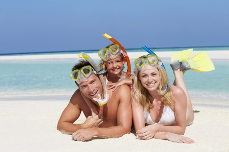 snorkelling: Family With Snorkels Enjoying Beach Holiday