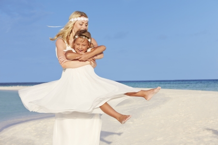 Bride With Bridesmaid At Beautiful Beach Wedding photo