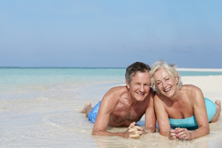 Senior Couple Enjoying Beach Holiday Stock Photo - 19530443