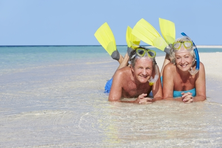 snorkelling: Senior Couple With Snorkels Enjoying Beach Holiday