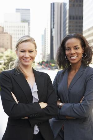 african business woman: Portrait Of Two Businesswomen Outside Office