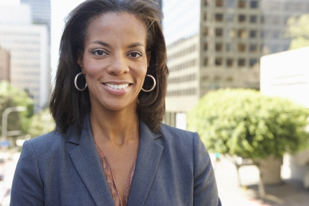 african america: Portrait Of Businesswoman Outside Office