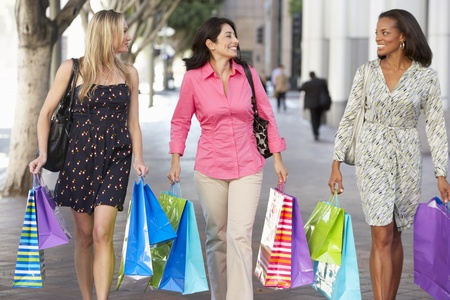 Group Of Women Carrying Shopping Bags On City Street Stock Photo - 19530896