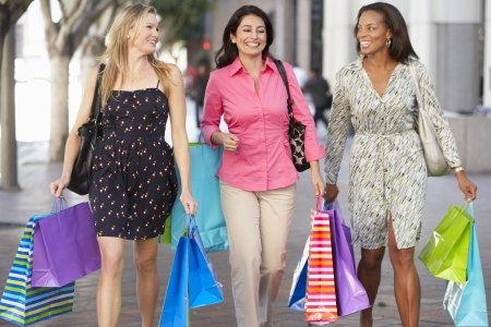 women friends: Group Of Women Carrying Shopping Bags On City Street