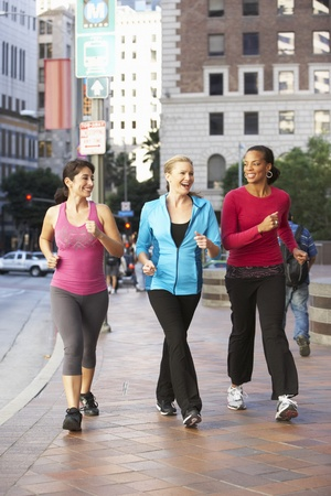 Group Of Women Power Walking On Urban Street photo