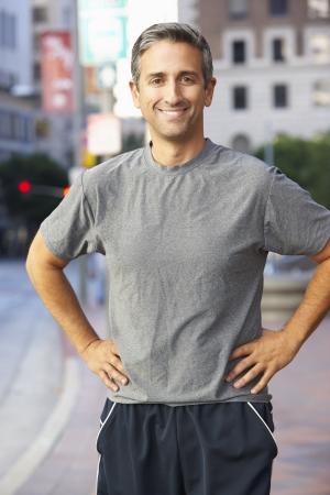40s: Portrait Of Male Runner On Urban Street