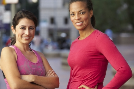 Portrait Of Two Female Runners On Urban Street photo