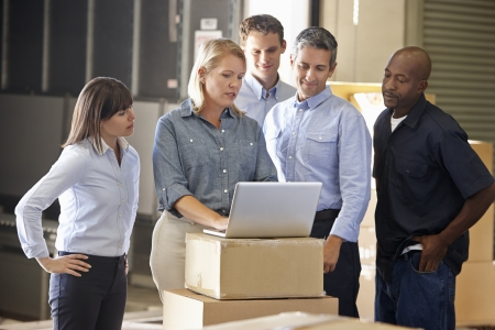 small business team: Workers In Distribution Warehouse