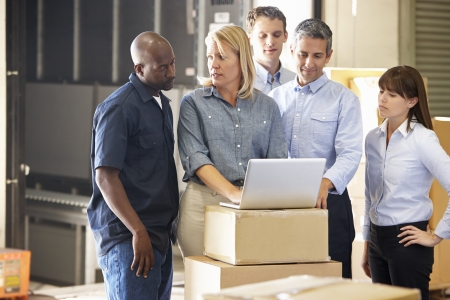 small business owner: Workers In Distribution Warehouse