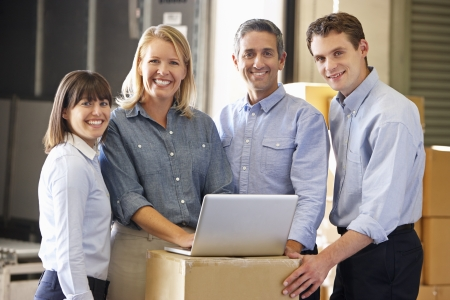 small business team: Portrait Of Workers In Distribution Warehouse Stock Photo