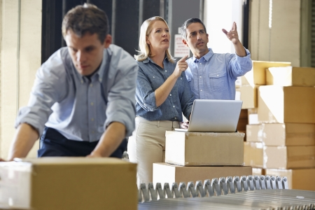 shipping order: Workers In Distribution Warehouse