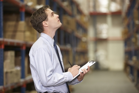 warehouse worker: Manager In Warehouse With Clipboard