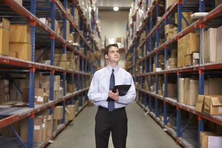 Manager In Warehouse With Clipboard Stock Photo - 19530467