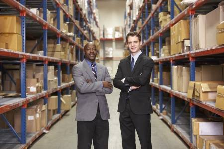 black business men: Portrait Of Two Businessmen In Warehouse Stock Photo