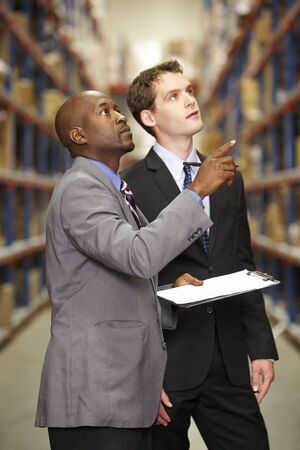 loading bay: Two Businessmen Having Discussion In Warehouse
